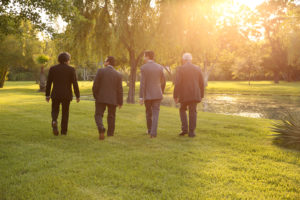 Walking with your men before the ceremony at Kemah Gardens